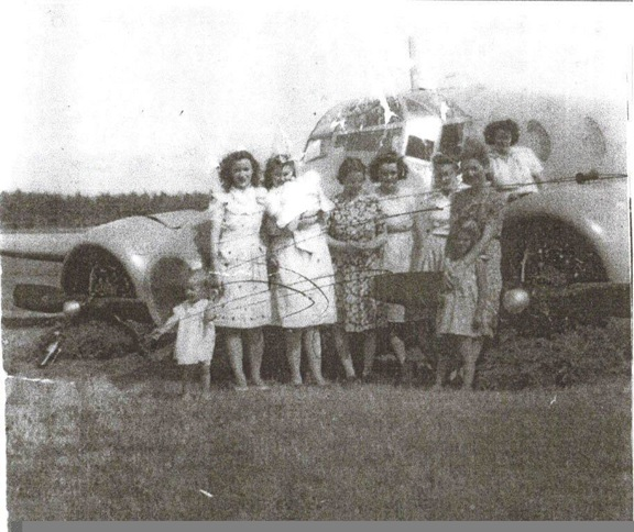 From the archives of Bonnie McGrath, Glenelg NS (with permission) Caption: Not sure of the names here. My Aunt Ella is on the front right (with the child in front of her). (This picture came from Elsie (Archibald) MacDonald). Photograph 1