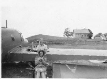 From the archives of Bonnie McGrath, Glenelg NS (with permission) Caption: Bonnie's father, Bob Archibald and Aunt Ella (Hattie) Archibald. Photograph 3