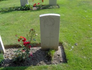 Headstone of Oney O'Keefe, buried at La Laiterie Military Cemetery, Belgium.
