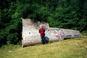 Photograph Irving Allen standing in front of wing in Robert Walsh's yard - 2000